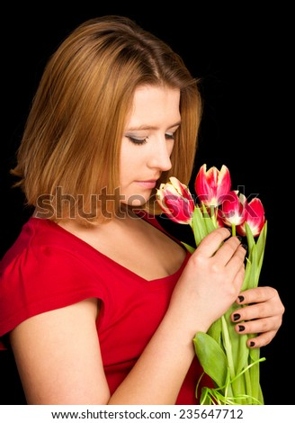 Attractive woman with flowers on color background