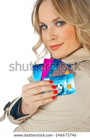 attractive woman with hands full of credit cards - stock photo