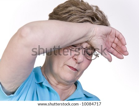 Attractive woman with headache pain - stock photo