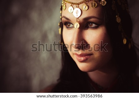 Attractive woman with indian indian tikka. Traditional indian jewellery on indian woman head. Potrait of indian girl with traditional indian accessories - stock photo