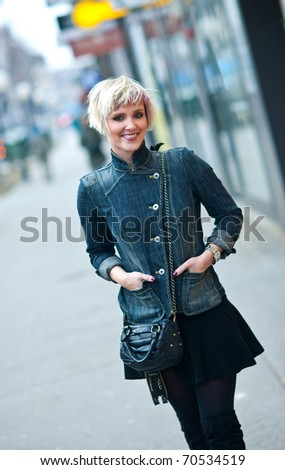 attractive woman with interesting hair walking in the city