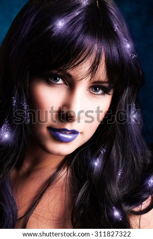 attractive woman with magical light effects in the hair - stock photo