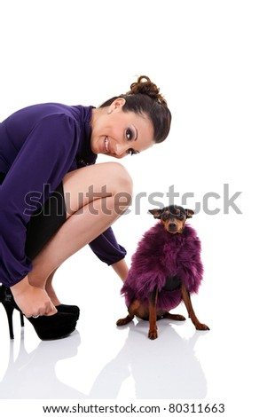 attractive woman with miniature pincher  in fur coat, isolated on white background - stock photo