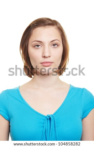 Attractive woman with neutral blank expression looking into camera - stock photo