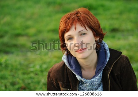 Attractive woman with red hair smiling happy headshot - stock photo