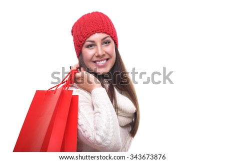Attractive woman with shopping bags isolated on white background. - stock photo
