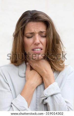 Attractive woman with throat problems - stock photo