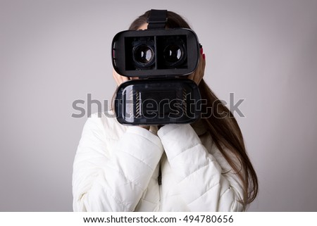 Attractive woman with virtual reality glasses