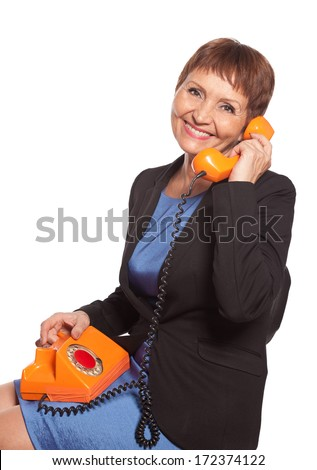 attractive woman 50 years with vintage telephone - stock photo