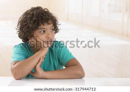 Attractive 8 year old boy making thinking expression - stock photo