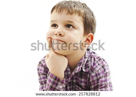 Attractive 6 year old boy making thinking expression. Isolated on white background  - stock photo