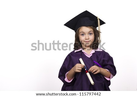 Attractive 5 year old girl in over sized large graduation cap and gown with diploma over white background - stock photo