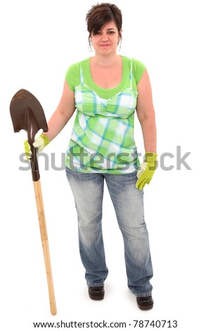 Attractive 45 year old overweight woman with shovel and garden gloves over white background.