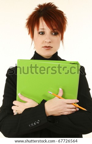 Attractive 30 year old teacher or business woman with green binder serious expression. - stock photo