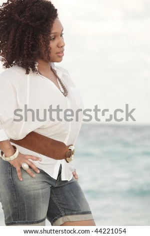 Attractive young African American female at the beach - stock photo