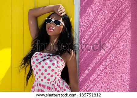Attractive young african american woman wearing sunglasses - stock photo