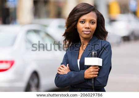 attractive young african female news reporter  - stock photo