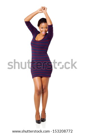 attractive young african woman dancing on white background - stock photo