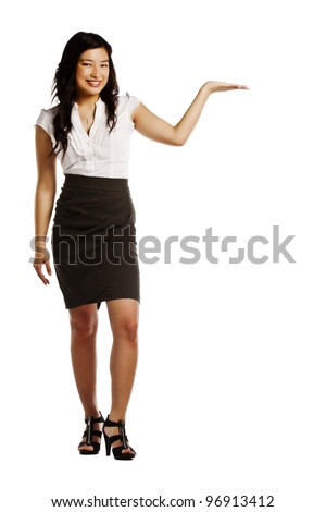 Attractive young asian business woman presenting your product against white background - stock photo