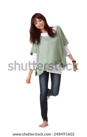 Attractive young Asian woman, full length portrait isolated on white studio background. - stock photo