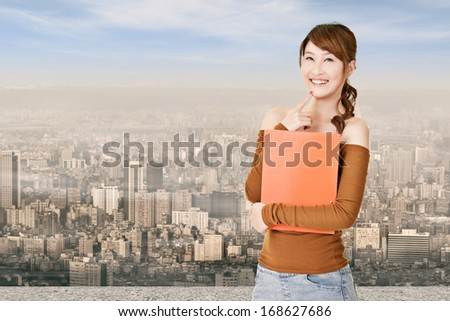 Attractive young Asian woman hold document, closeup portrait. - stock photo