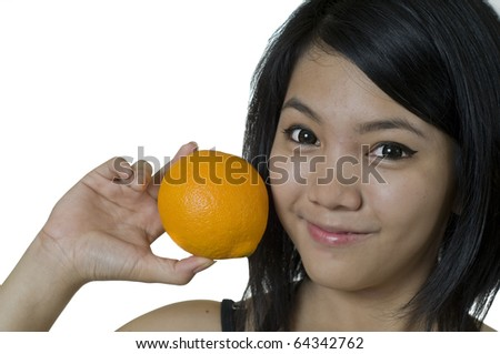 Attractive young Asian woman holding an Orange - stock photo