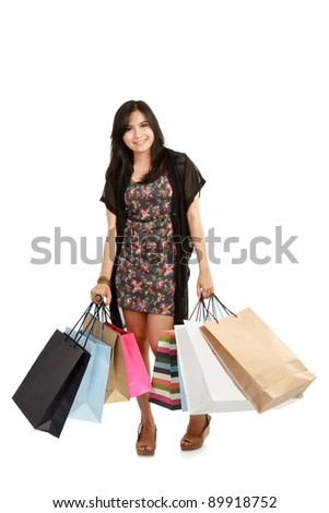 Attractive Young beautiful asian Woman with Shopping Bags isolated on in white background - stock photo