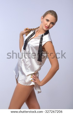 Attractive young Beautiful blond woman posing in shirt and gesturing - stock photo