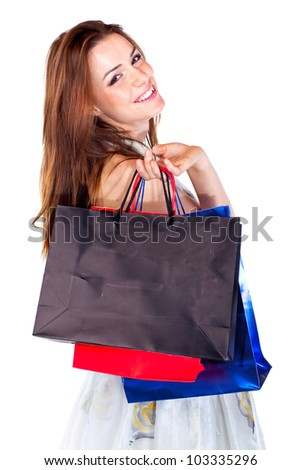 Attractive young beautiful woman with shopping bags over white background.