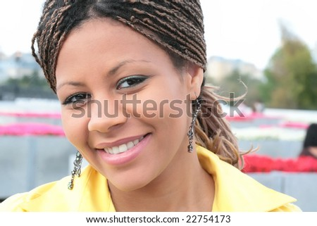 attractive young black woman in yellow clothes - stock photo