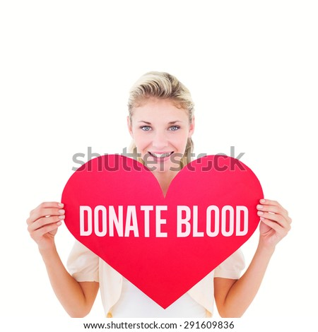 Attractive young blonde showing red heart against donate blood - stock photo