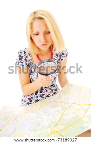 Attractive young blonde studying map over white background