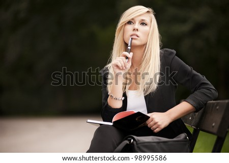 Attractive young Blonde with a book - stock photo
