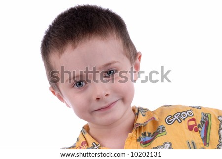 attractive young boy up-close over a white background