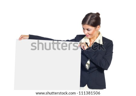 Attractive young brunette businesswoman woman holds big placard on the right. Isolated against white background.