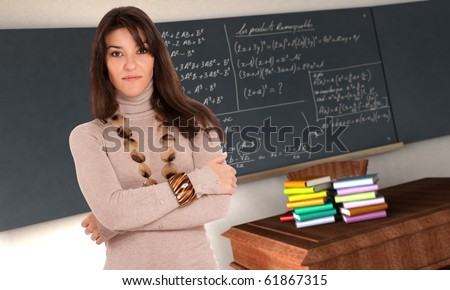 Attractive young brunette in a classroom - stock photo