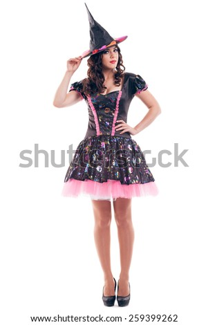 Attractive young brunette woman dressed as a fairy or witch isolated on white background - stock photo