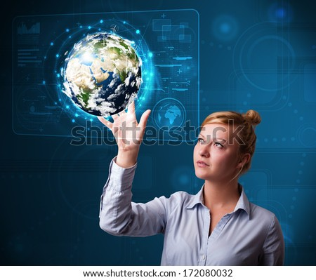 Attractive young buinesswoman touching high-tech 3d earth panel - elements of this image furnished by NASA - stock photo