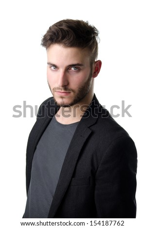 Attractive young business man looking in camera, serious expression, isolated on white - stock photo