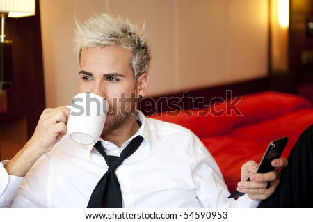 Attractive young business man making a phone call - stock photo