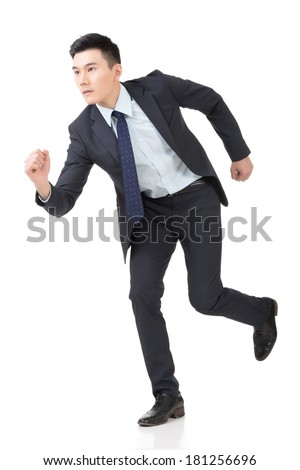 Attractive young business man running, full length portrait isolated on white background. - stock photo