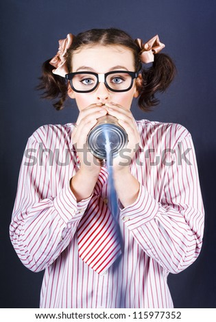 Attractive Young Business Person Wearing Nerd Eye Glasses Talking Down The End Of A Homemade Can Phone - stock photo