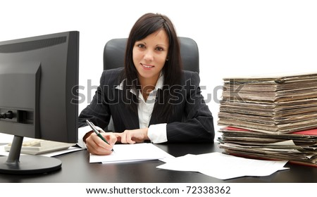 Attractive young business woman in black suit at her desk