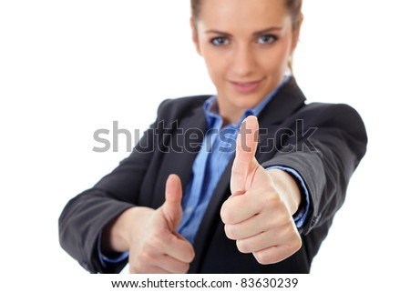 Attractive young business woman shows both thumbs up, focus on foreground, isolated on white - stock photo