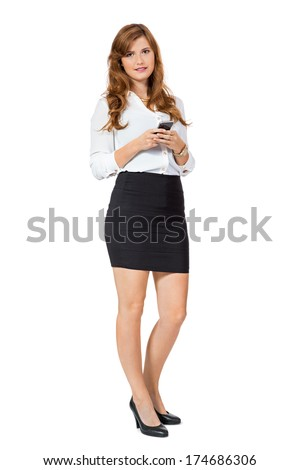 attractive young business woman with mobile phone smartphone isolated