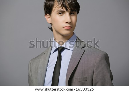 Attractive young businessman in gray suit.