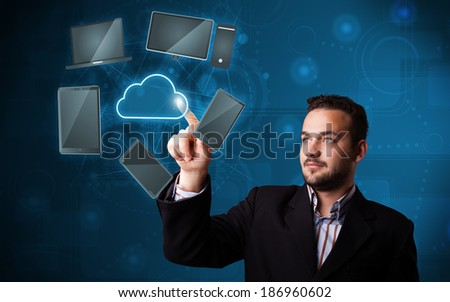 Attractive young businessman touching high technlogy cloud service - stock photo