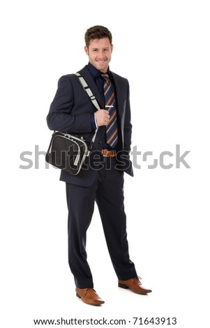 Attractive young businessman with a laptop bag on sholder. Studio shot. White background. - stock photo