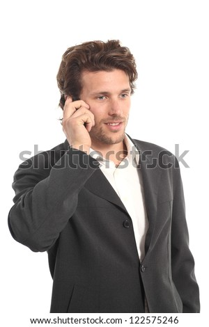 Attractive young businessman with a phone on a white isolated background