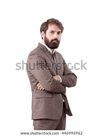 Attractive young businessman with beard and crossed arms isolated on white background - stock photo